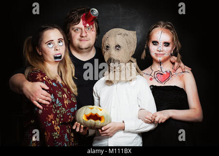 Halloween Family. Happy Father, Mother and Children Girl and Boy in Halloween Costume and Makeup - Stock Photo