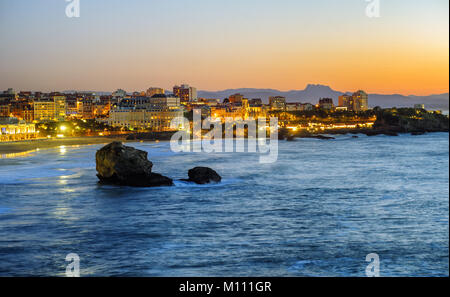 Biarritz city in the Bay of Biscay, France, panoramic view with Pyrenees mountains and Atlantic ocean on sunset - Stock Photo
