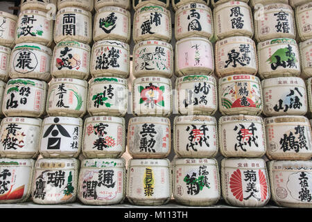 Barrels of sake wrapped in straw - Stock Photo
