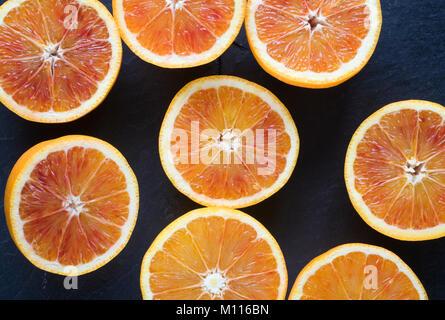 Citrus x sinenesis. Blood Oranges on slate. - Stock Photo