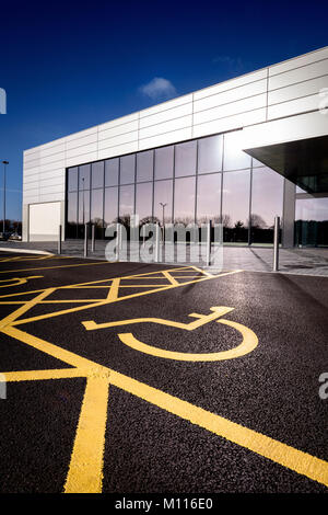 A bright freshly-painted disabled parking bay in a Hampshire retail park. - Stock Photo