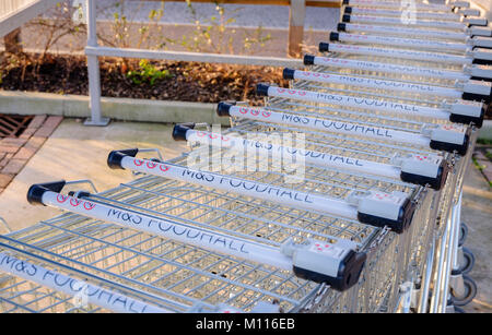 M&S Foodhall trollies parked and ready for shoppers in the store car park. - Stock Photo