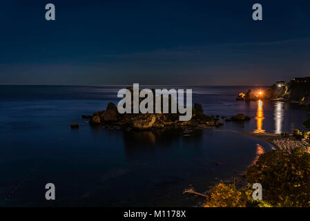 Isola Bella Nature Reserve - also known as the 'Pearl of the Mediterranean sea', seen at night during the summer - Stock Photo