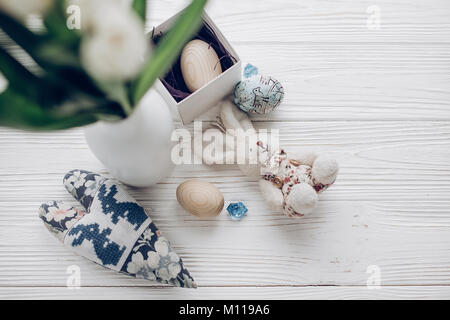 easter egg bunny top view. decorated and wooden eggs and rabbit on rustic wooden table with space for text. greeting - Stock Photo