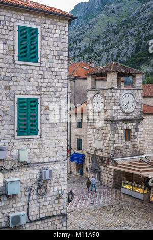 Clock Tower dates from 1602 on the Square of Arms of Old Town in Kotor coastal city, located in Bay of Kotor of - Stock Photo
