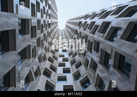 Low-angle shot of a modern skyscraper with many windows - Stock Photo