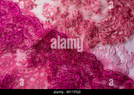 Assortment of pink lace on white background. can be use as a background and wallpaper - Stock Photo