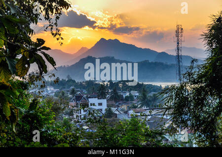 Sunset over UNESCO World Heritage Luang Prabang, Laos - Stock Photo