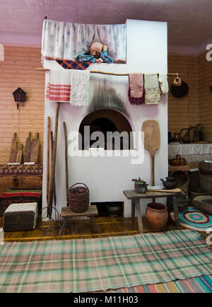 Duhovshchina, Russia - August 15, 2012: Imitation of old Russian stove in the hut - Stock Photo