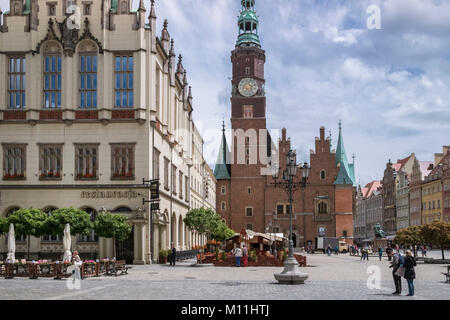 Traditional architecture in Wroclaw Old Town, showing west elevation of the Town Hall tower and clock, Wroclaw, - Stock Photo