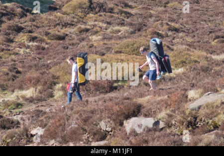 Two Young Caucasian Men Walking With Backpacks, The Roaches, Peak District National Park, Staffordshire, England, - Stock Photo