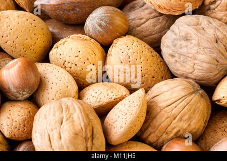 Close up of a variety of unshelled nuts, a rich source of protein - Stock Photo