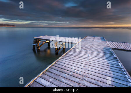 Early morning at frozen small pier at beach in Sopot. Winter landscape in Sopot, Poland. - Stock Photo