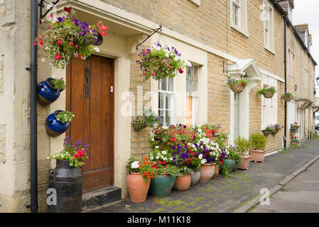 Flower baskets and planters adorn a town house in Church Walk Melksham Wiltshire England UK - Stock Photo