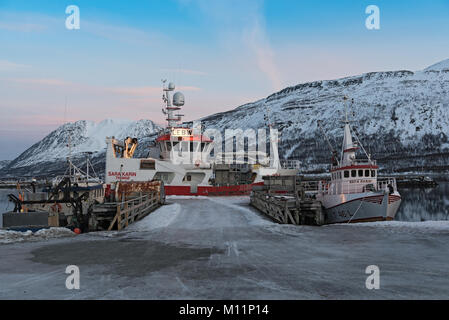 Boats in the sheltered harbor at Nord-Lenangen, Lyngen, Troms county, Norway - Stock Photo