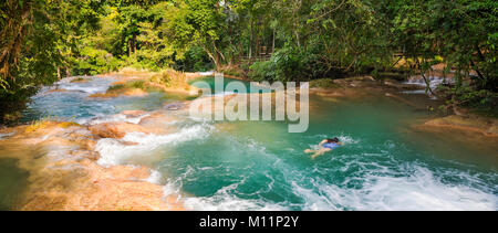 Woman swimming in natural pools of Agua Azul  near Palenque in Chiapas, Mexico - Stock Photo