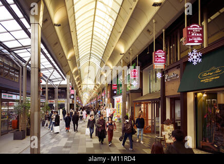 Shinkyogoku covered street shopping district, Teramachi shopping arcade, full of people and stores, Kyoto, Japan - Stock Photo