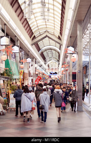 Shinkyogoku covered street shopping mall, Teramachi shopping arcade, busy with people popular historical shopping - Stock Photo