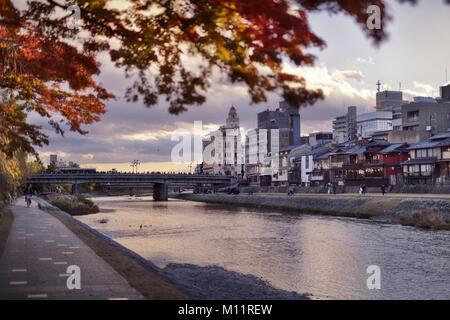 Shijo bridge over Kamo-gawa, Kamo River, in autumn sunset city scenery, Kyoto, Japan 2017. - Stock Photo