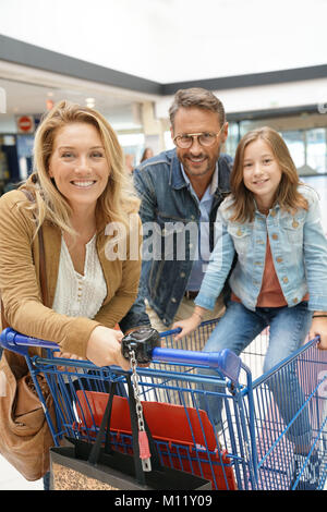 Portrait of happy family going to the grocery store - Stock Photo