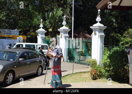 Peradeniya  Kandy Central Province Sri Lanka Peradeniya Royal Botanical Gardens Main Entrance Gates Hawker selling - Stock Photo