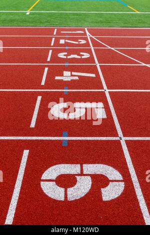 Start line on athletics track - Stock Photo