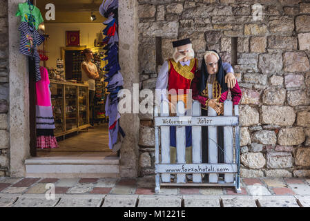 Gift shop in passuge of Sea Gate, main entrance to Old Town of Kotor coastal city, located in Bay of Kotor of Adriatic - Stock Photo