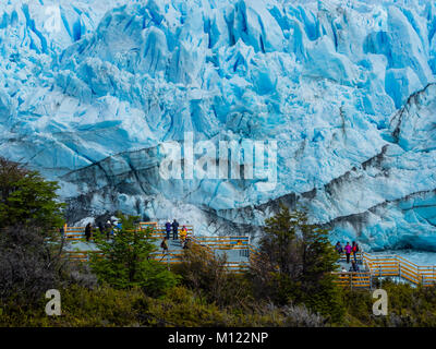 Tourists on a viewing platform at the Perito Moreno glacier,region of El Calafate,province of Santa Cruz,Patagonia,Argentina - Stock Photo