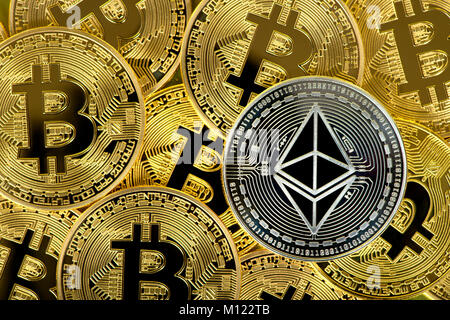 Cryptocurrency,digital currency,silver coin Ethereum on gold Bitcoin coins - Stock Photo