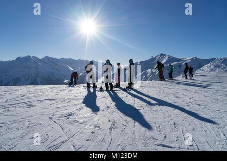 Skiers in the skiing area Penken Horberg,Mayrhofen,Zillertal,Tyrol,Austria - Stock Photo