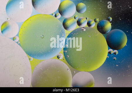 Abstract image with colorful circles and shapeless bodies on a colored background. - Stock Photo