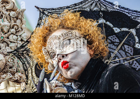Woman wearing mask in the Venice Carnival 2017 in Italy - Stock Photo