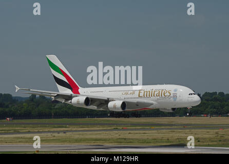 DUESSELDORF, GERMANY - JULY 1, 2015: Inaugural flight of Emirates Airline with Airbus A380-800 from Dubai to Duesseldorf - Stock Photo