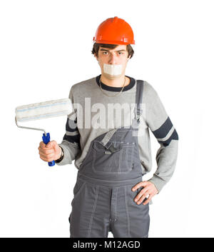 A young man in working grey clothes and orange hard helmet man with tape over mouth. Isolated on white background. - Stock Photo