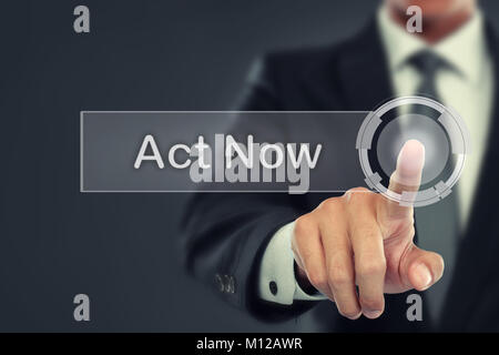 portrait of Businessman push to  Act Now button on virtual screen - Stock Photo