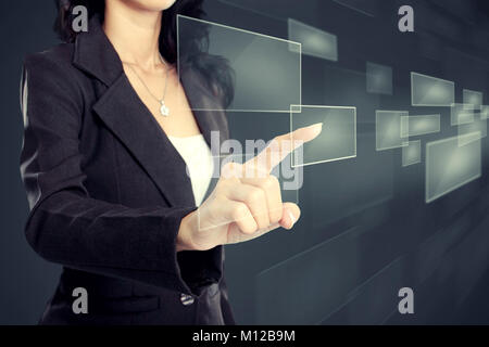 Business woman pressing virtual media type of buttons - Stock Photo