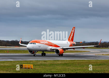 Airbus A320-214, registration OE-IJH, operated by EasyJet, taxiing in foggy conditions at Manchester International - Stock Photo