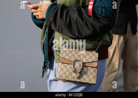 MILAN - JANUARY 14: Woman with Gucci bag and green and black bomber jacket before Dsquared 2 fashion show, Milan - Stock Photo