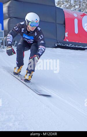 Snowboard competitor in parallel slalom has started  from the start gate. Rogla ski resort, Slovenia. - Stock Photo