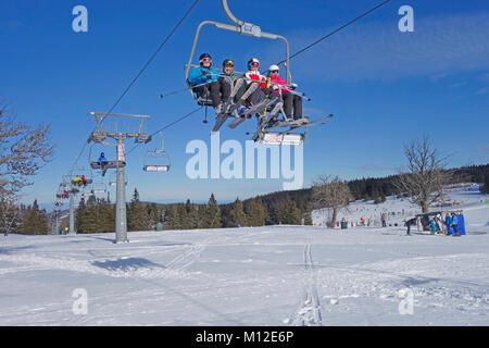 People riding the chair lift. Rogla ski resort, Pohorje, Slovenia. - Stock Photo
