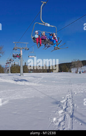 People riding the chair lift. Rogla ski resort, Pohorje, Slovenia. - Stock Photo