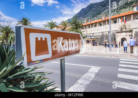 Sign pointing Sea Gate, main entrance to the Old Town of Kotor coastal city, located in Bay of Kotor of Adriatic - Stock Photo