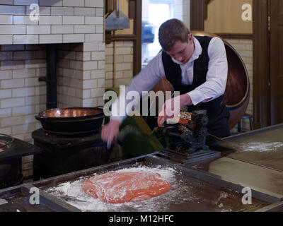 STANLEY, COUNTY DURHAM/UK - JANUARY 20 : Man making cough candy at the North of England Open Air Museum in Stanley, - Stock Photo