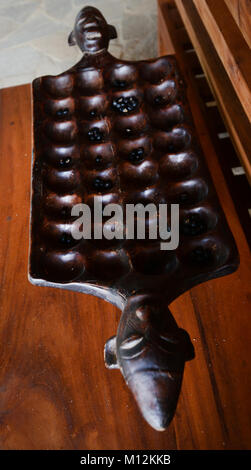 A traditional Congolese Mancala game. - Stock Photo