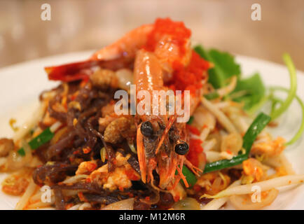 Thai Style Stir-fried Riceberry Noodles or Pad Thai Topped with Prawn Served on White Plate - Stock Photo