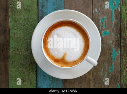 Hot Coffee with Heart Shaped Latte Art in a White Cup on Colored Rustic Style Wooden Table,Top View with Selective - Stock Photo