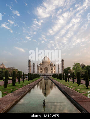 Beautiful reflection of Taj Mahal early in the morning after sunrise, Agra, India - Stock Photo