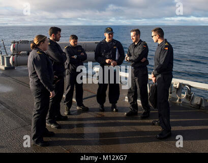 ATLANTIC OCEAN (Jan. 21, 2018) Lt. Robert Harris, middle, the plans and tactics officer aboard the Arleigh Burke - Stock Photo