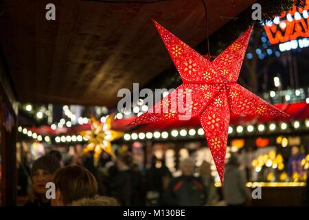Star Christmas Paper Lantern on a christmas market. - Stock Photo