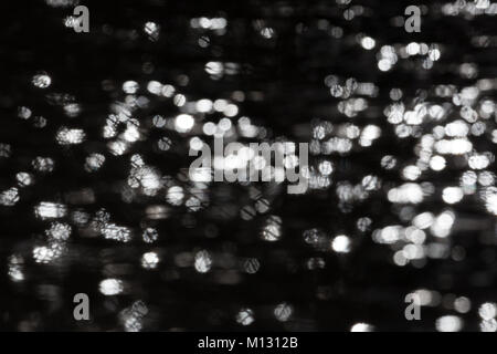 sparkling natural round flares reflections in water - Stock Photo